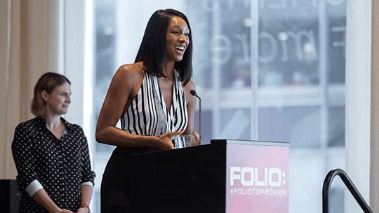 Woman receiving award at podium